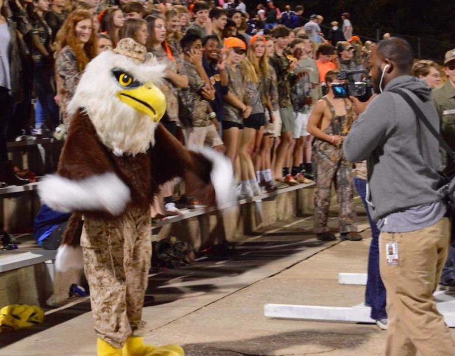 The Eagle hams it up for the TV camera at a Stratford football game.