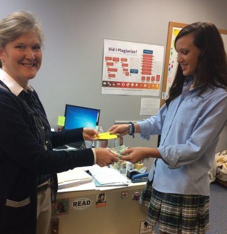 Beta Club president Bailey Toole sells spaghetti supper tickets to English teacher Dr. Ann Dromsky on Tuesday morning.