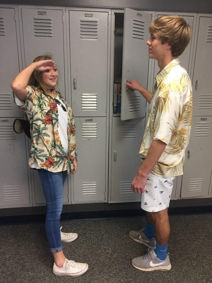 Molly Groves and Jamie O'Quinn talk about coconuts on Tropical Tuesday. (Photo by Cap Patel)