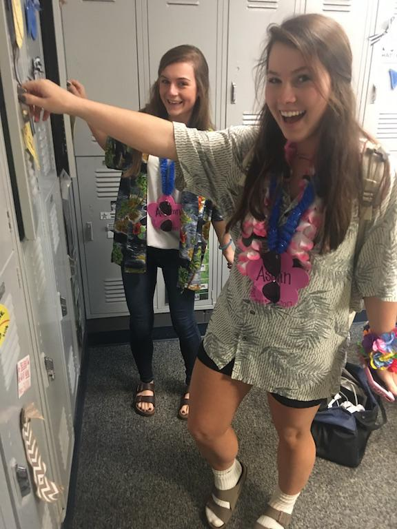 Autumn Land and Ashlin Jackson look cheerful, dressed in floral, opening their lockers. (photo by Kaitlyn Neel)