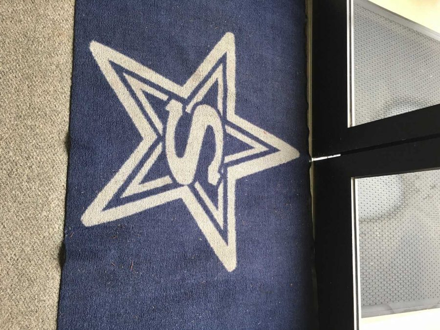 Stratford Star on a doormat used for traveling out of the Olson Library (photo by Molly Garud)