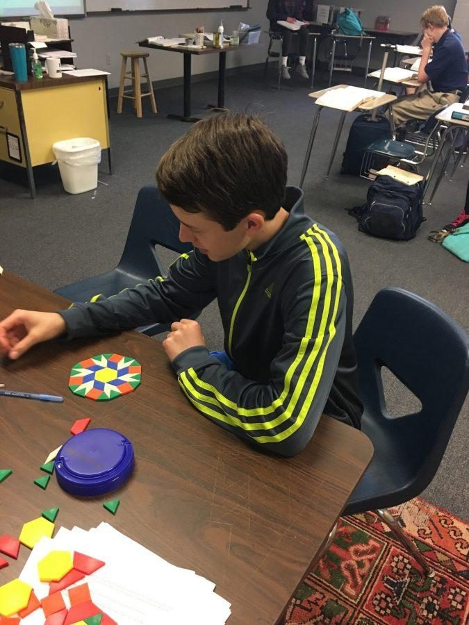 Carter Eddleman plays with polygons while wearing comfy workout clothes (photo by Molly Garud)