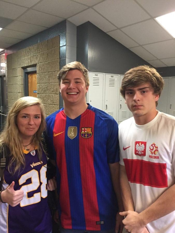 Caroline Durkee, Stephen Durso  and Carter Griffin sporting their teams' jerseys.