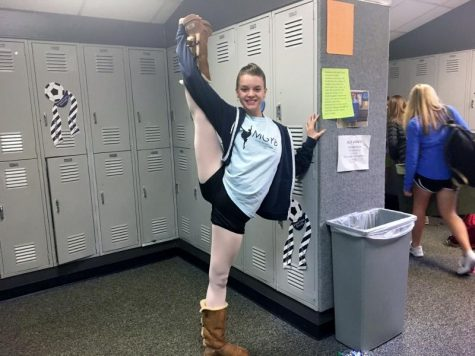 Junior Murray McCormack dances her way through the day.