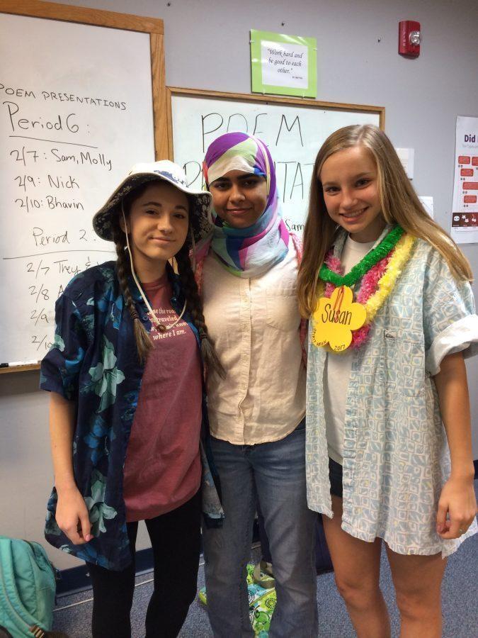 Maya Rubinstein, Asma Karim, and Susan Hightower enjoy the beginning of Tropical Tuesday.  (Photo by Neely Shah)