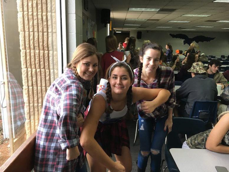 Maggie Greer, Coleman Rozier, and Anna Katherine Boswell hick around on Hillbilly Day.