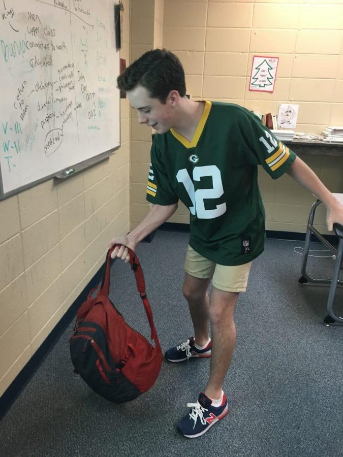 Grey Faulkner showing off his athletic skills with his book bag.