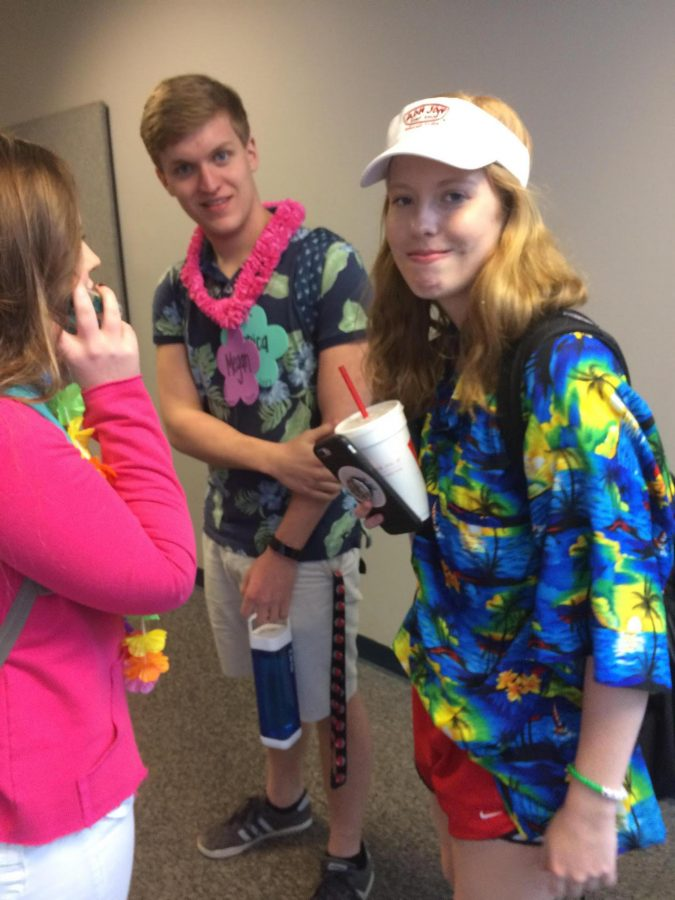 Seniors Jessica Gratigny, Walker Gibbons and Claire Rinehart (from right to left) all sport Hawaiian themed attire for Tropical Day.