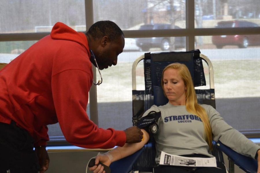 Soccer Coach Kate Blankenship prepares to give blood under the supervision of the Red Cross in the Science Center on Wednesday.