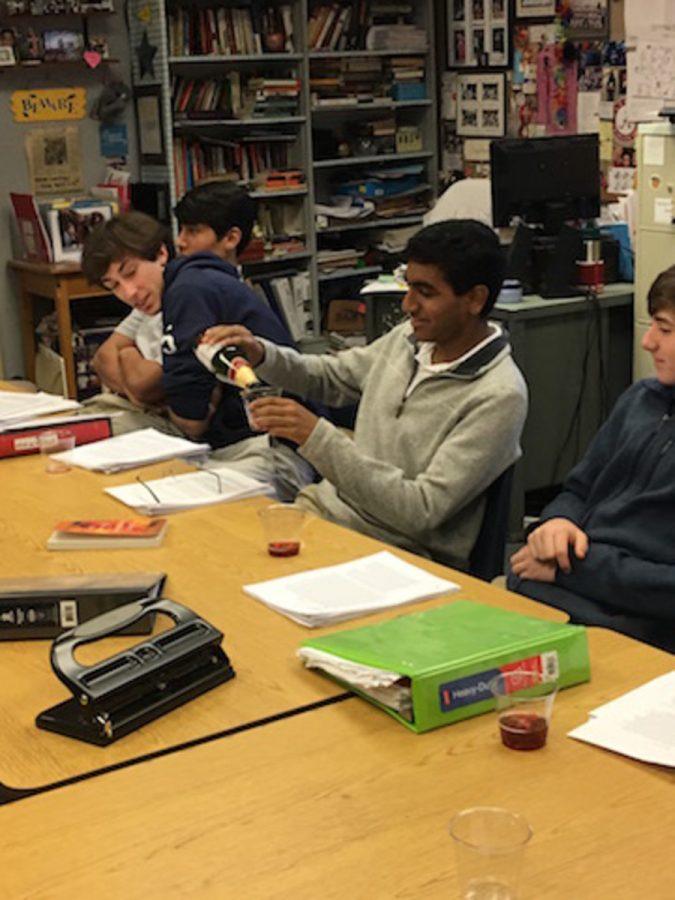 Junior Sahan Vangala pours himself and his AP English classmates some sparkling grape juice