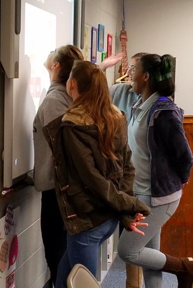 Sophomores Reese Ellis, Samantha Atkinson, Maggie McCullough, and Meggie Aivolotis play extreme 2048
