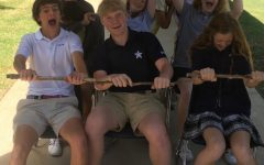 Members of the Gazebo Middle School staff re-enact a roller coaster ride on the walkway at the front of campus
