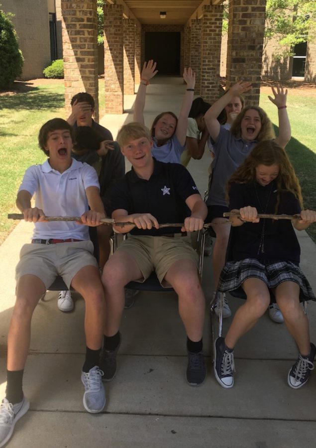 Members+of+the+Gazebo+Middle+School+staff+re-enact+a+roller+coaster+ride+on+the+walkway+at+the+front+of+campus