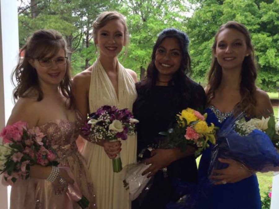 Gracie+Childers%2C+Grace+Deedrick%2C+Zainab+Siddiqui+and+Rosalee+Spivey+strike+a+pose+before+last+year%27s+prom.