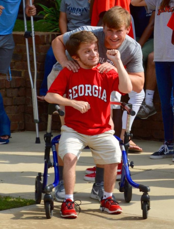 Aaron Arnold and Crawford Edwards share a moment on Friday -- the last day of classes for seniors