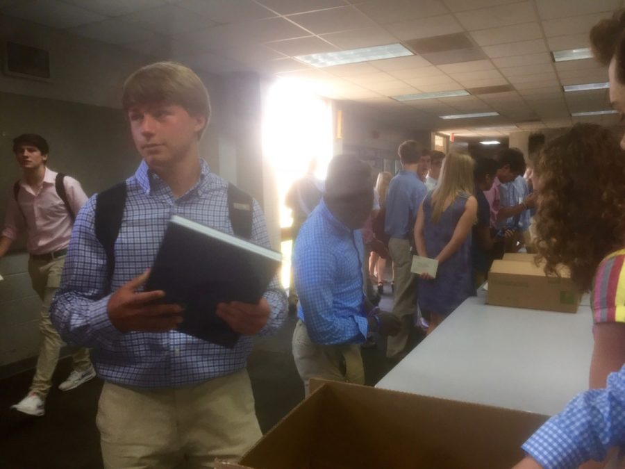 Students pick up yearbooks after Honors Day ceremony