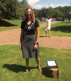 Art teacher Ms. Anastasia Fink wore an eclipse blouse for the occasion