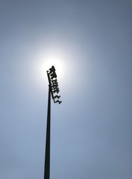 Sun reflects from lights at football stadium
