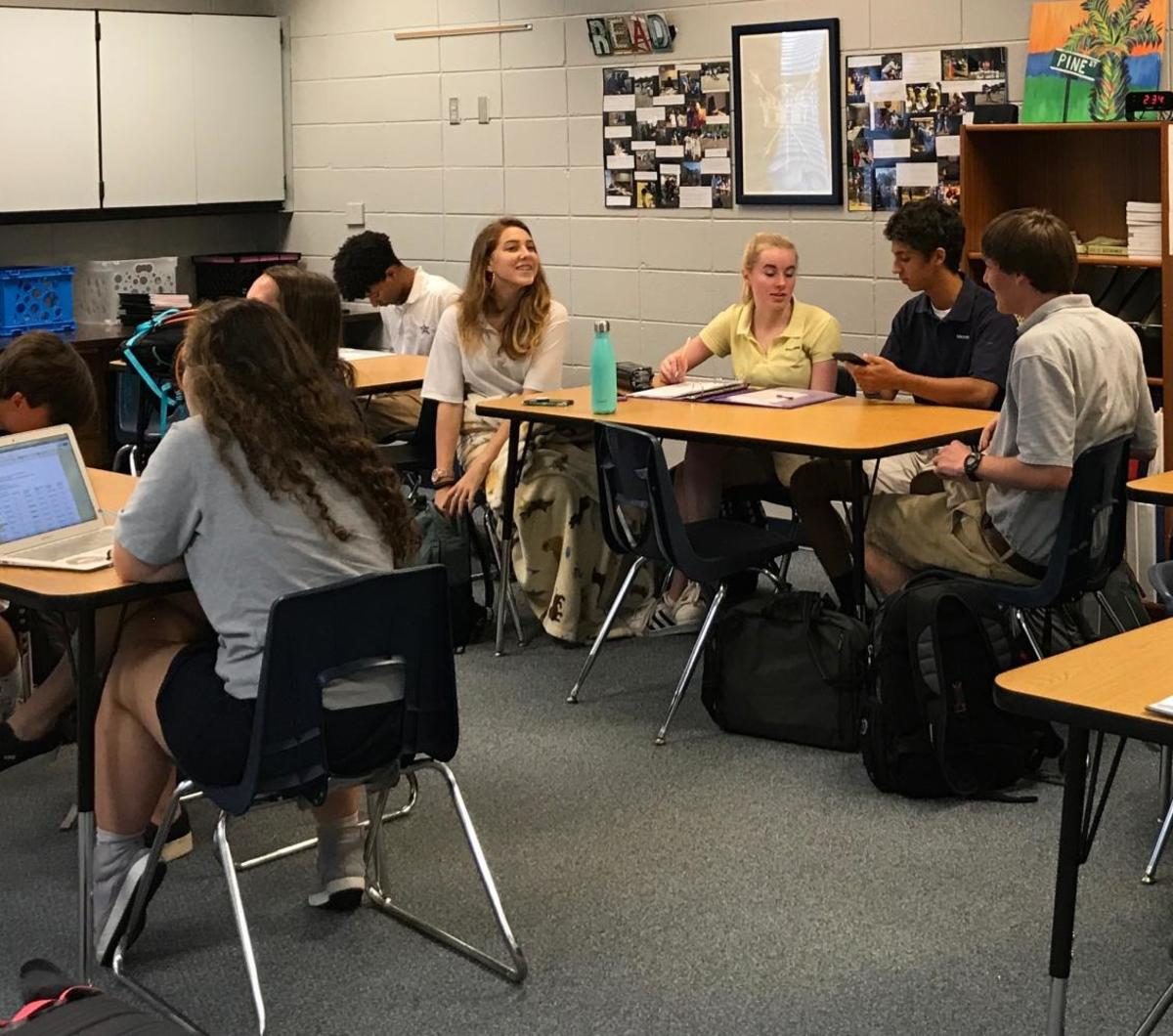 Students talk before class in Dr. Ann Dromsky's sixth period Senior English