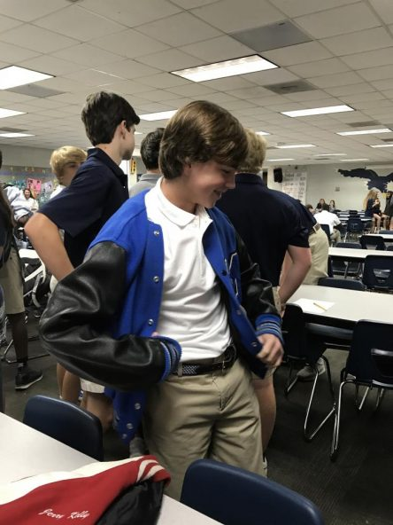 Freshman Thomas Jones tries on a letter jacket during break on Tuesday in the cafeteria. A representative from the Neff Co. visited Stratford to give students playing sports and in the band the opportunity to be fitted for letter jackets and sweaters.