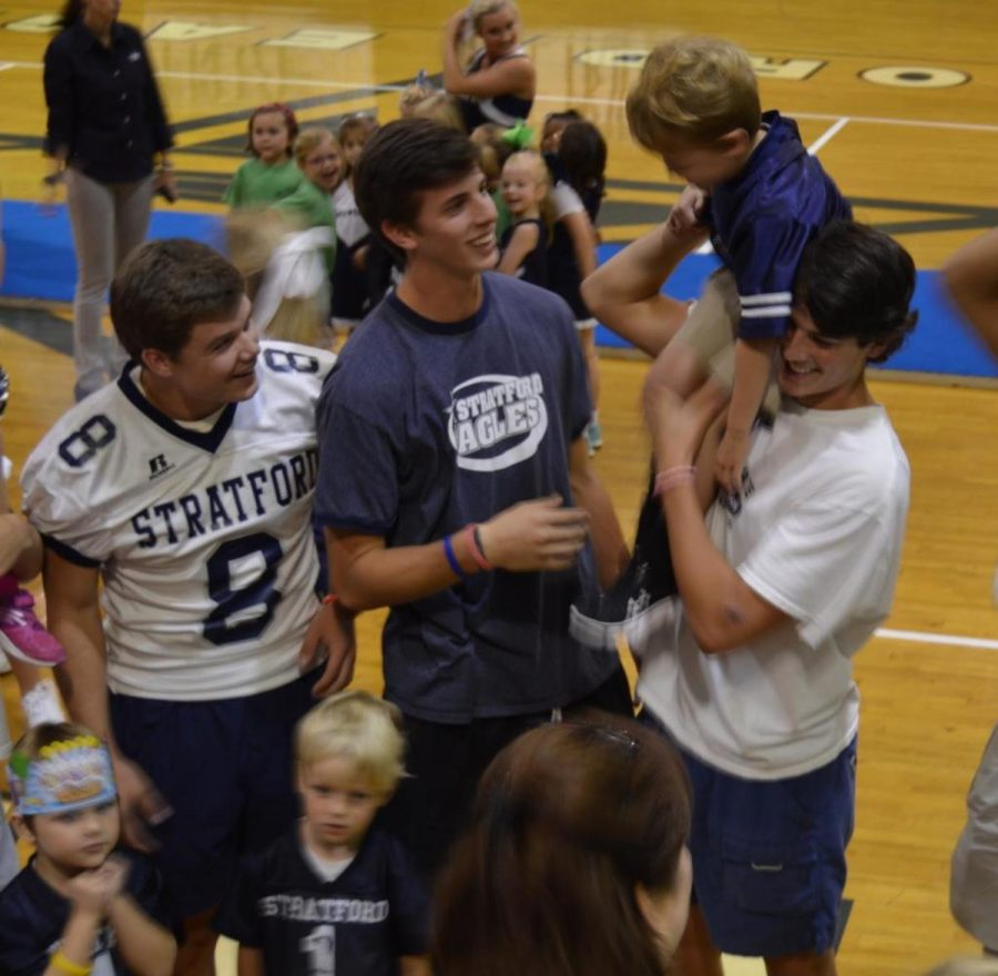 Stratford+varsity+football+players+Larsen+McDaniel%2C+Nathan+Hunt+and+Trey+Giles+have+fun+with+students+from+the+preschool+after+Friday%27s+pep+rally+in+The+Grady.