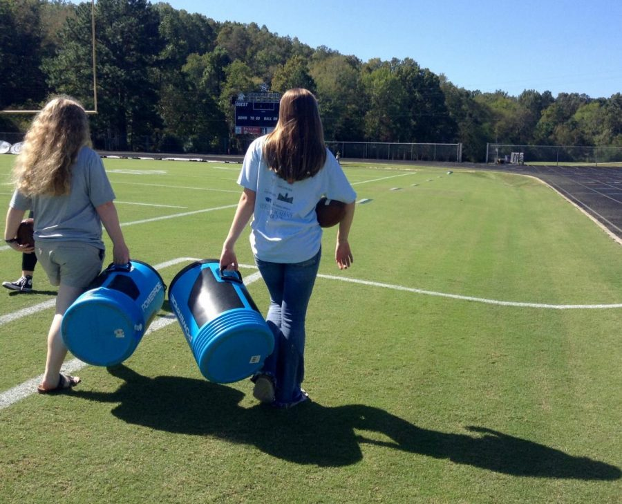Ninth-graders EmmaJane Canady, left, and Miller Cranford are football managers