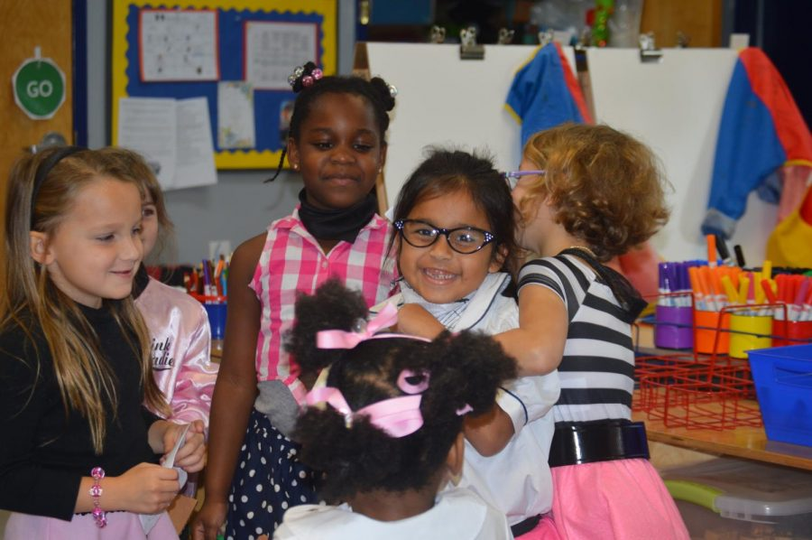 Students+in+the+Preschool+celebrate+Tuesday%27s+Open+House+for+prospective+familes.