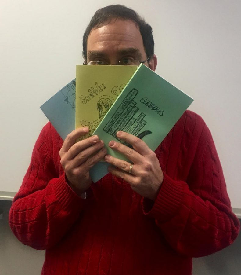 Dr. Frank Katz, an advisor for Stratfords literary magazine, holds several recent issues of Scribbles.