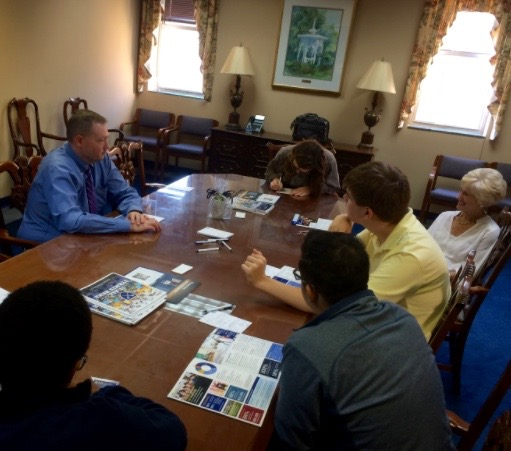Upper school students listen to Chris Pace, senior associate dean with the admissions office at Emory University on Monday. Pace met with students in the Stratford board room and provide information about the Atlanta school.