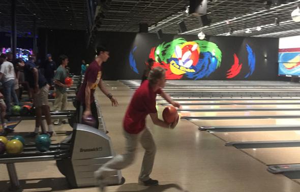 Junior McKinley Thompson, left, and senior Josh Bevill take aim at a recent practice