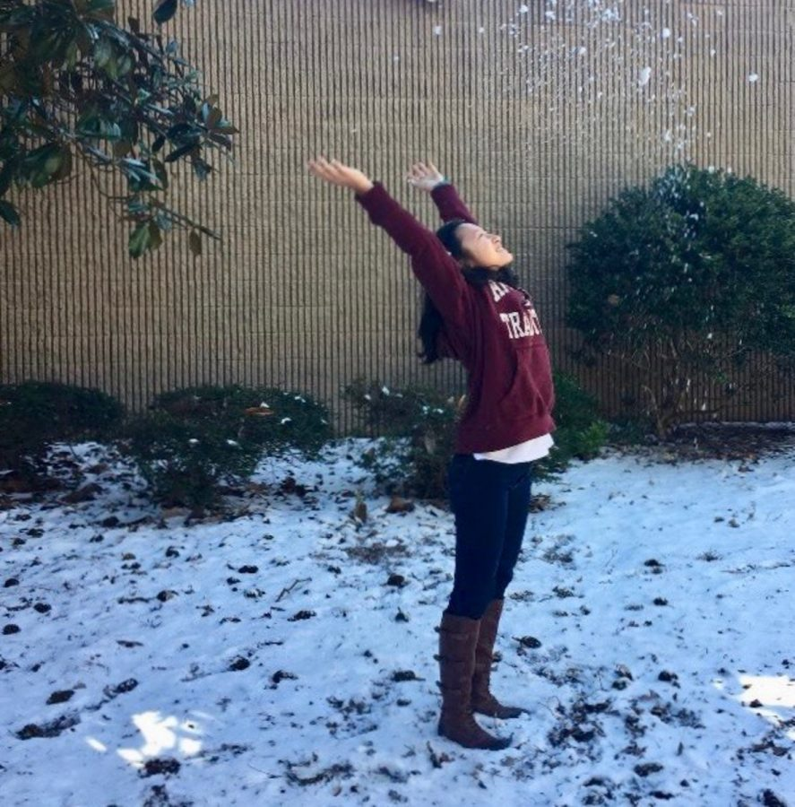 Freshman+Jocelyn+Tang+plays+in+the+snow+on+campus+on+Thursday