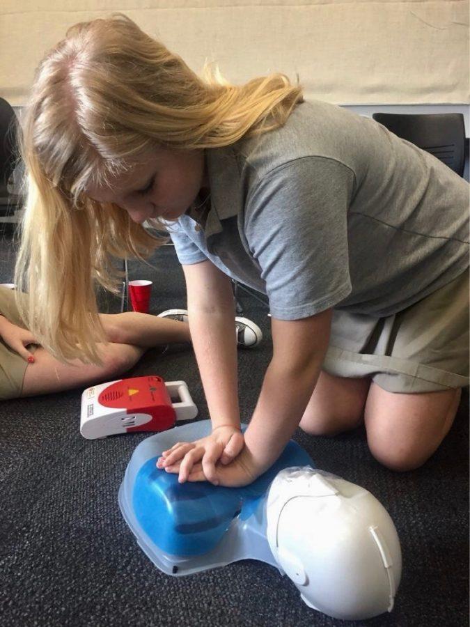Students receive training in CPR, defibrillator