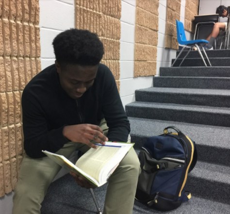 Sophomore Tomi Sagade reads a book during study hall