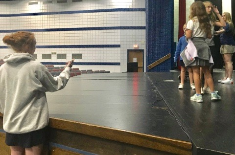 Sophomore Riley Davis instructs Lower School students in