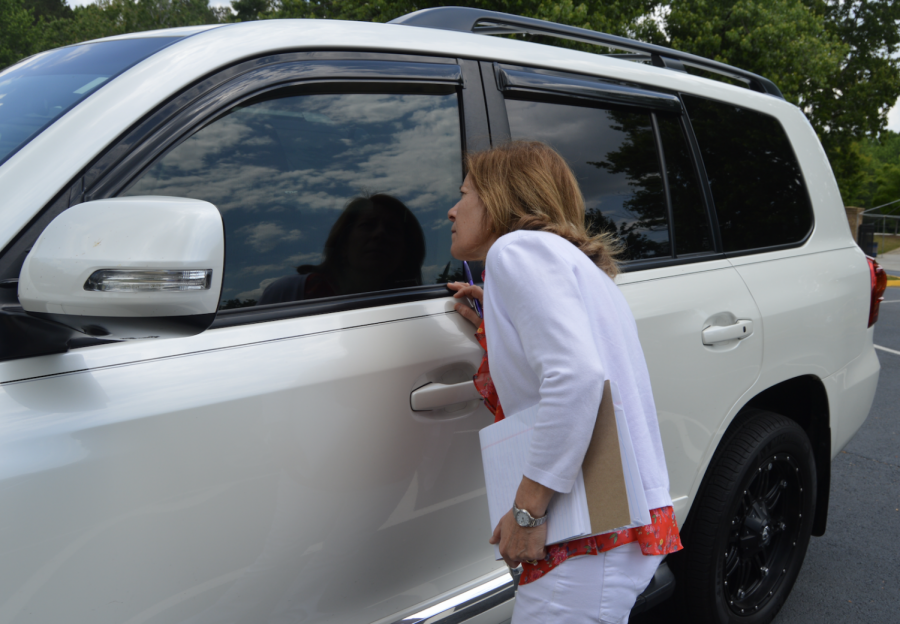 Assistant Principal Mrs. Theresa Ferrari checks the parking lot on Tuesday to make sure underclassmen are not parking in the senior spots