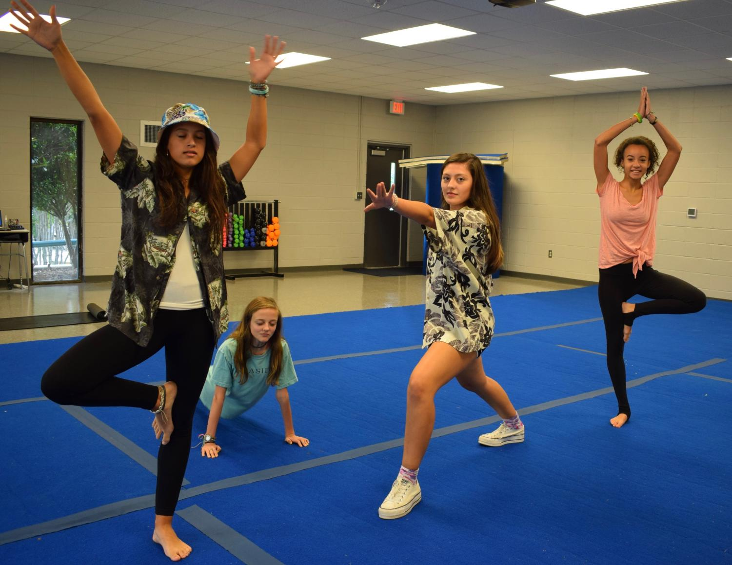 Taylor Justice, Madelyn Poss, Marlie Potts, Annika Brooks participate in 5th period yoga.