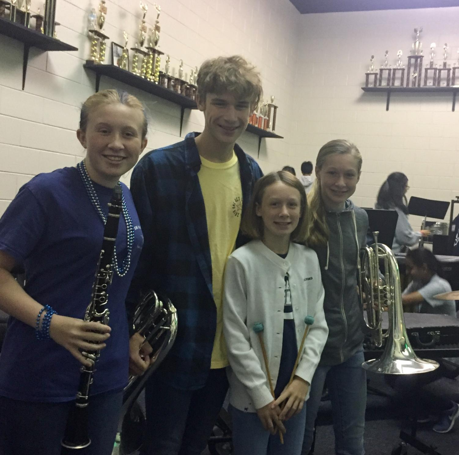 (L-R) Nora, Benjamin, Ginny, and Gracie Jorgensen pose in the band room.