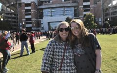 Madeline Davis, right, with her mother, Leah Oldham  in front of Bryant-Denny Stadium in Tuscaloosa on November 10.
