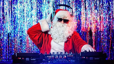 DJ Santa Claus mixing up some Christmas cheer. Disco lights in the background.; Shutterstock ID 121218244; Job: -