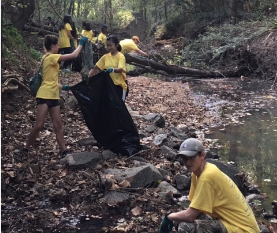 (L-R) Maddie Fackler, Jocelyn Tang, and Andrew Moring took part in the river clean-up at Amerson Park last month.