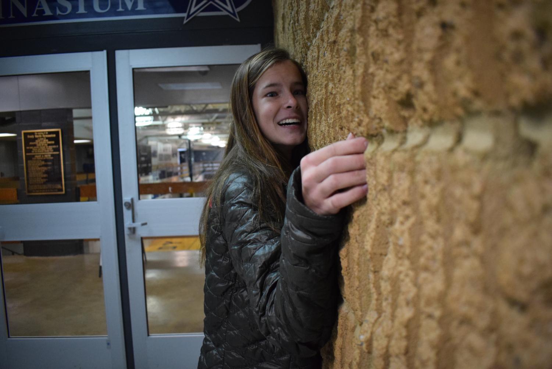 Helen Pope hugs the Death Wall