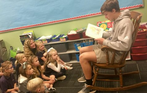 Basketball players read to children