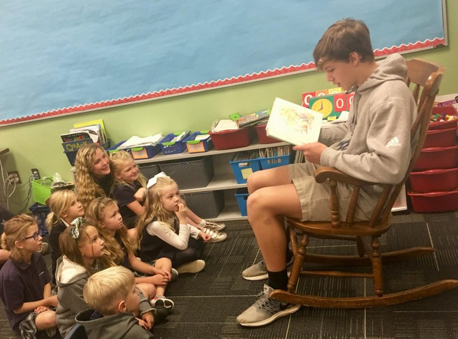 Basketball+players+read+to+children