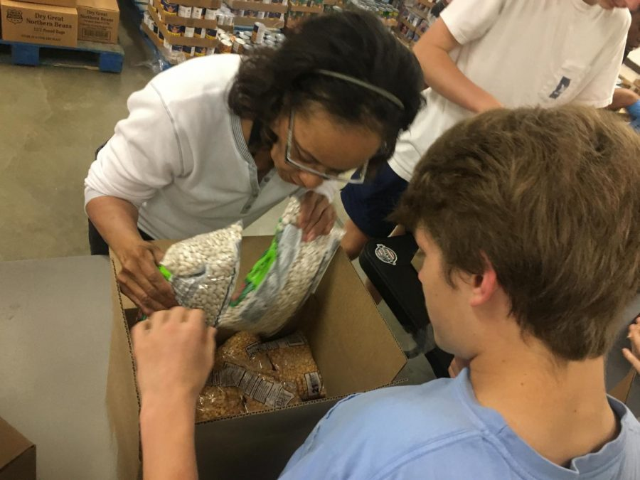 Jay Lee helping pack beans and cans at the Macon Food Bank