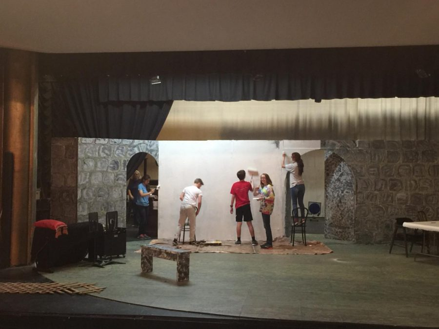 A group of sophomores paint props at Macon Little Theatre.