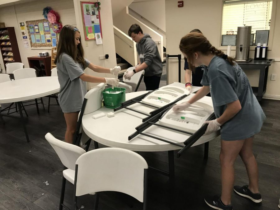 Freshmen Camilla Veale, Jack Minette, Anna Caroline Hutchinson, and Anna Mincey work together to clean chairs and tables at Mulberry United Methodist.