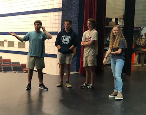 Matt Newberry, Hampton Tiller, Carter Barfield, and Sarah Pyles give the students instructions on the impromptu skit game they played Tuesday in Drama Club.