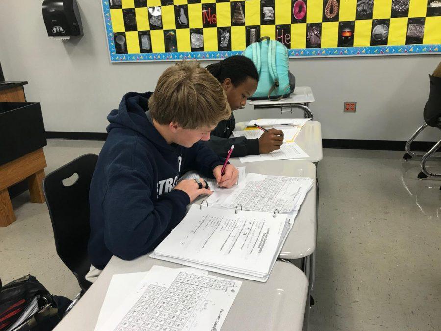 Carson Chambless and Mekhi Lyder doing chemistry homework