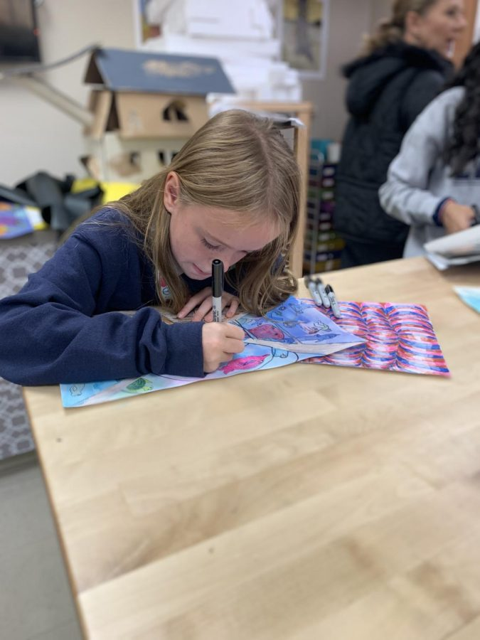 Elle Tomek working on her artwork in art class.