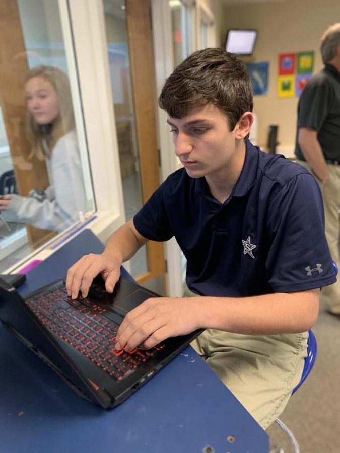 Mason Spiegel working hard in design class.